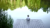 doca : Little boy at pier on a lake Stock Footage