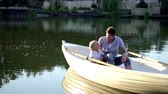 prole : Family in a boat in summer