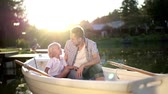prole : Dad and son in boat