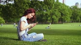 Центральная Америка : Smiling woman with phone in Central park