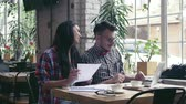 estudantes : Attractive young couple in cafe Stock Footage