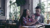 estudantes : Young couple at work Stock Footage