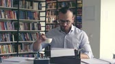 coffee machine : Writing man typing on a typewriter Stock Footage