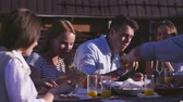 pizza cheese : Young friends eating pizza outdoors Stock Footage