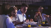 Young people eating pizza outdoors Stok Video