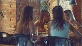 feminine : Young girls talking in a restaurant