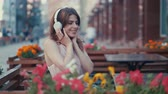 freude : Beautiful woman listens to music Stock Footage