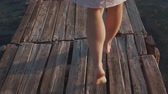 Girl walking on a wooden pier