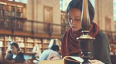 egyetemi : Attractive girl with a book in the library