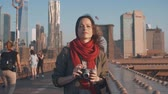 pontes : Attractive photographer with a retro camera on a bridge Stock Footage