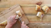 Seamless loop - Cutting bread on a wooden table, view from above, HD video