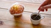 Seamless loop - Woman hand stirring coffee in a cup with a spoon, HD video