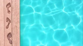 Seamless loop - Wet footprints by a swimming pool, summer concept, HD video