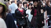 TOKYO, JAPAN: Crowd of people in Takeshita dori, a busy shopping street in Harajuku district Stock Footage