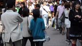 TOKYO, JAPAN - MAY Timelapse of the crowd of people in Takeshita dori, a busy shopping street in Harajuku district