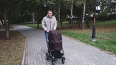 babalık : Father walks with the pram walking in the park