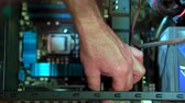 connector : Close-up of male hand uninstalling videocard in PC. Personal computer repair Stock Footage