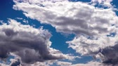 motion timelapse : White clouds timelapse. Soft white clouds in the blue sky timelapse