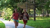 bieg : Children and education, sister and brother, schoolchildren run along the path towards the camera. Slow motion on the street Wideo