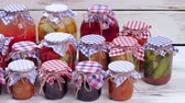 przetwory : Glass jars with canned food. Beautiful glass jars of preserves.