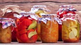 przetwory : Organic vegetables and fruits. Organic vegetables in glass jars. Wideo