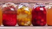 preserved : Organic compotes. Canned fruit drinks in glass jars. Delicious drinks.