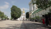 kult : Courtyard of the Orthodox Church. Parishioners go in the service of the church. Historical church with gold domes. The old cathedral.