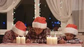 paper : Little Santas writes a letter. Stock Footage