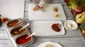 cut : Knife cuts cooked meat. White plate with cooked pear. Chef is slicing duck steak. Sweet fruit and fried meat. Stock Footage