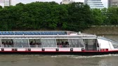életmód : Paris, France - 14.06.2016. Boat moving on the river. Embankment of Seine. Tour around Paris.