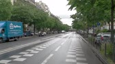 asmak : Paris, France - 14.06.2016. Rapid movement on the road. Dont exceed speed limit. Streets of Paris at daytime.