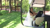 priceless : Bride and groom in vehicle. Wedding couple in the mirror. Our journey into new life. Young and happy. Stock Footage