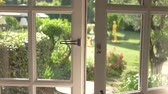 relaxation : Open door and nature. Green plants and sunlight. House with a garden. Stock Footage