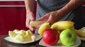 cut : Housewife cut banana for fresh smoothies. Useful fruit. Dietary breakfast. Stock Footage