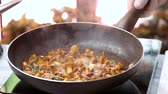 cantharellus : Mushrooms frying in slow motion. Chanterelles, rosemary and garlic. Stock Footage