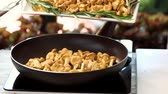 cantharellus : Mushrooms are falling in slow-mo. Golden chanterelles in frying pan. Autumn food recipes.