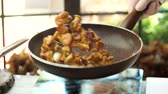 cantharellus : Frying pan in slow-mo. Chanterelles with spices. Easy mushroom recipes.
