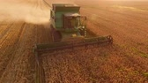 arazi sahibi : Combine on golden field. Agribusiness and technologies.