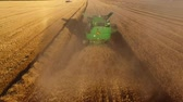 arazi sahibi : Field, combine and dust. Wheat field.