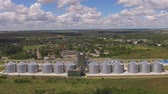 arazi sahibi : Grain storage tanks, aerial view. Biggest agricultural company. Stok Video