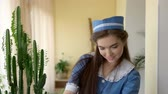 flirting : Young housemaid smiling. Happy woman at work. Psychology of flirting. Stock Footage