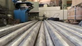 durability : Stack of metallic pipes indoor. Long pieces of metal. Stock Footage