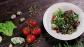 dorblu : Salad with shrimps and ingredients on a wooden background. Stock Footage