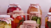 przetwory : Preserved fruits and vegetables close-up. Harvesting of food products for the winter. Wideo