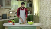 cucumber soup : Man cutting cucumber. Bearded guy in apron. Easy cooking guide. Stock Footage