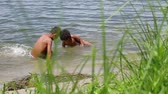 побережье : Two mulatto swimming in the river. Hot Africa.