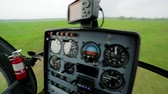 havayolu : Landing a helicopter on a green meadow. Panorama from cabin of the helicopter. Stok Video