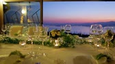 gümüş eşya : Beautiful wedding table setting on the background of the sea. Festive table at sunset.
