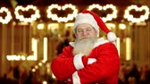 dobranoc : Santa showing thumbs up. Santa Claus, blurred carousel background. Best Christmas fairs.