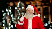 dobranoc : Happy Santa Claus, thumbs up. Santa, blurred lights background.
